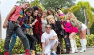 """Rock of Ages"" director, Adam Shankman (kneeling), with dancers before the ""Juke Box Hero"" scene was filmed.  Shankman took his two rescue dogs to the set every day."