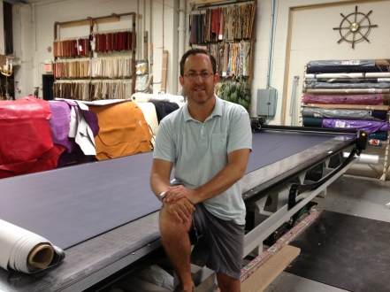 Andrew Grossman, manages his upholstery business based in a former dairy distribution warehouse on Second Avenue.
