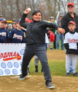 Janine Cinseruli, owner of Sea Grass Restaurant, throws the first pitch of the 2014 Peabody Massachusetts Little League season.  In 1974, after a landmark ruling, Cinseruli was the first-ever female Little League player.