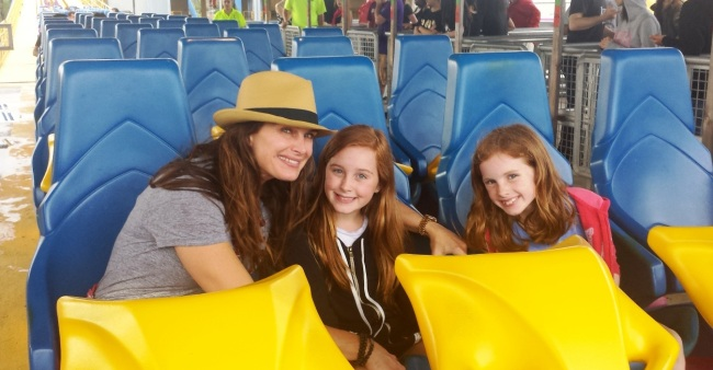 Actress Brooke Shields (left) prepares for a ride on Nitro while celebrating Mother's Day Weekend at Six Flags Great Adventure with daughters Rowan (center) and Grier (right). Along with husband Chris Henchy, the family visited the park for daughter Rowan's 11th birthday.