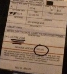 Highlighted and quadruple underlined on the faux ticket was the infraction - parking in a fire zone.  Circled was the $60 fine.  The date was overwritten with a marker as well.