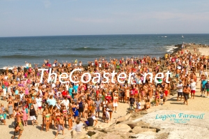 Allenhurst beach goers gathered for a photo op near the iconic lagoon and cove scheduled for removal later this year. Photo By The Coaster / Mike Booth