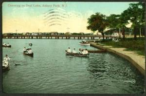 """A vintage postcard depicts canoeing on Deal Lake.  Friends of Deal Lake is organizing a """"meet the candidates"""" forum May"""