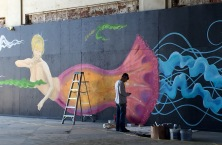 """Artist Pork Chop creating """"Jelly Lady"""" - his new mural in the Casino building on the Asbury Park waterfront."""
