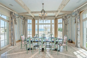 The informal dining room of Belle Mer overlooks the pool and Atlantic Ocean.