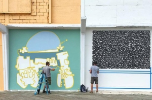 Artists Brad Hoffer and James Vance install their murals on the Sunset Avenue Pavilion. Photo Billy Mecca.